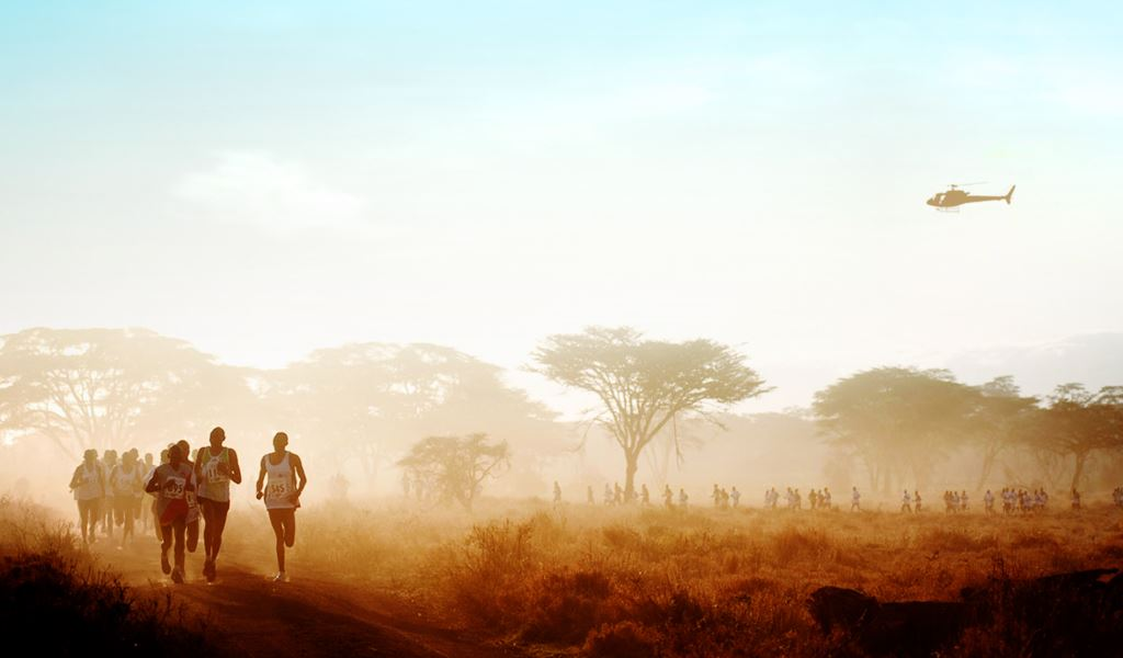runners on the lewa conservancy for the Lewa Marathon