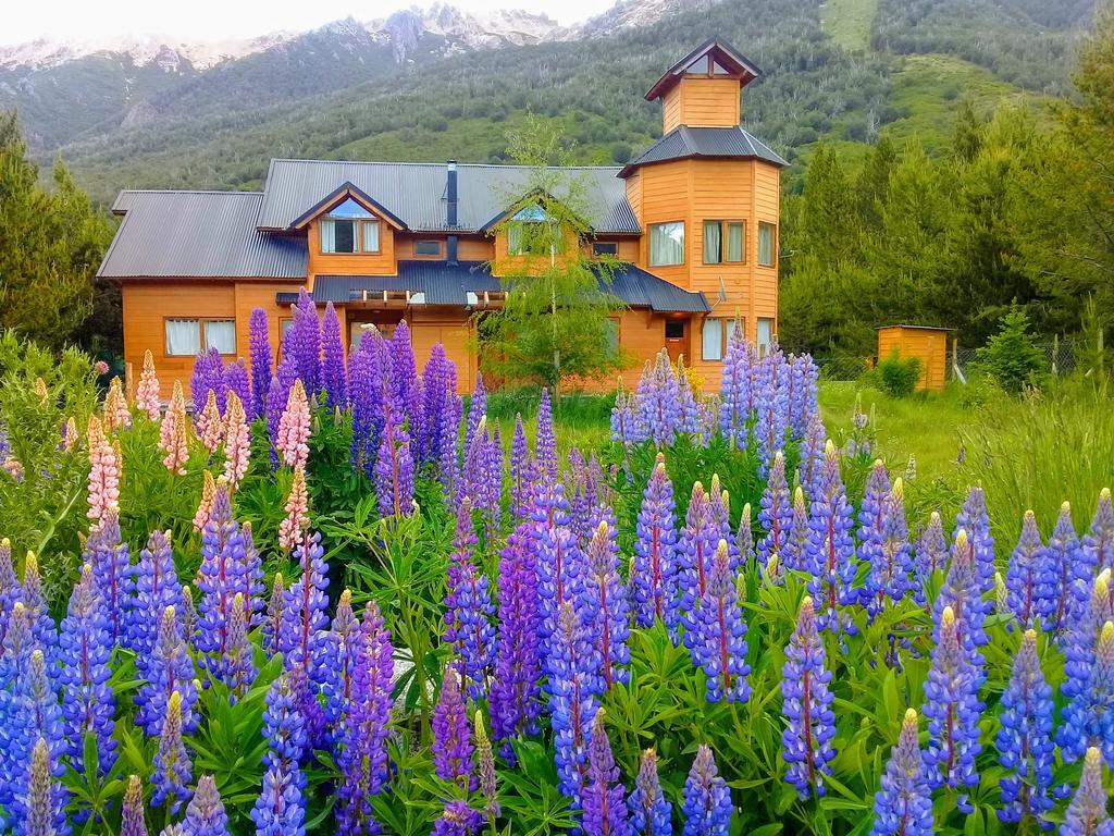 germanic looking hotel with purple wildflowers
