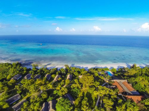 aerial view of the suites tucked into the trees along the shores of the Indian Ocean
