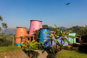 colorful buildings set in the lush forests of southern Bwindi Impenetrable Forest Uganda
