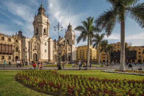 colonial cathedrals in a park with palm trees and small plantings