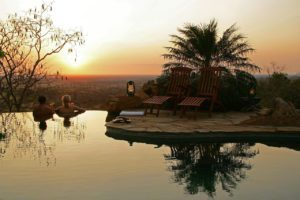 Watching the sunset in the infinity pool at Elsa's Kopje