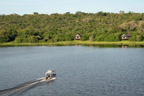 boat headed across Lake Rwanyakazinga towards Magashi Camp on the best Rwanda safari