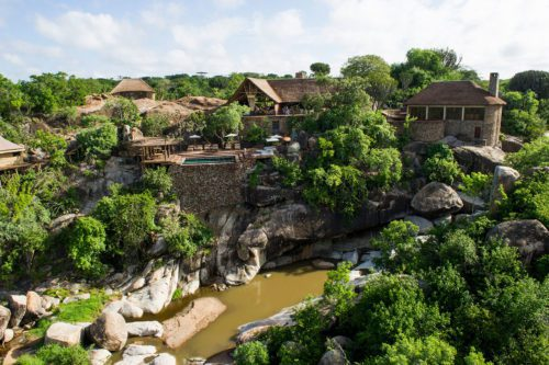 mwiba lodge built into the rocks overlooking the river and nestled in the trees