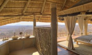 views over the African bush from the open air bathroom at Ikuka Safari Camp