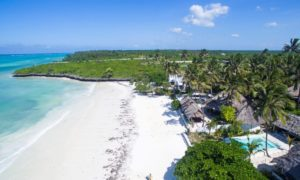 aerial view of Upendo's bandas and pool set on the sandy beaches and blue waters of Zanzibar