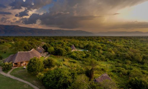 aerial view of Semliki Safari Lodge and the stunning valley with mountains in the distance