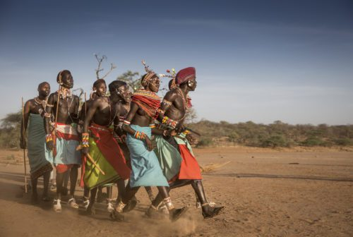 five samburu tribe members walking in line