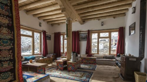main areas of Snow Leopard Lodge showing exposed beams and warm interiors