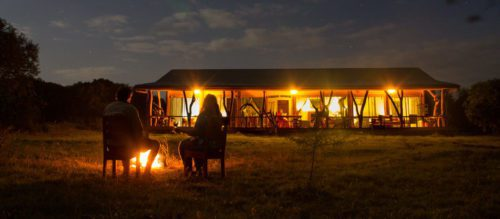 evening fire illuminating ol pejeta safari cottages