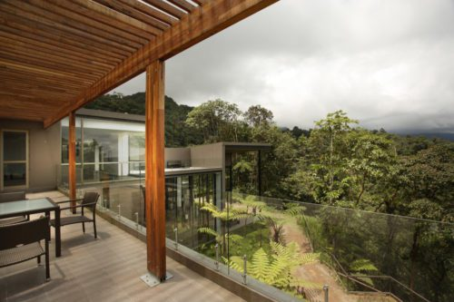 deck looking out to forest at Mashpi Lodge on safari in Ecuador
