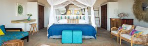 bedroom at azura marlin beach is white with splashes of blue and turquoise