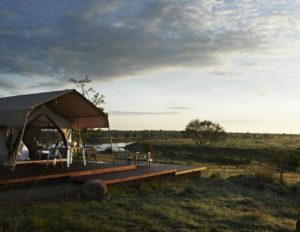 luxury tented camp built on wooden decking and overlooking the Serengeti plains