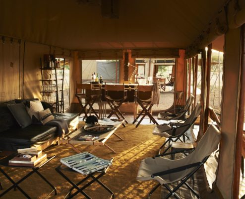 cozy interiors of a luxury tented camp in the Serengeti