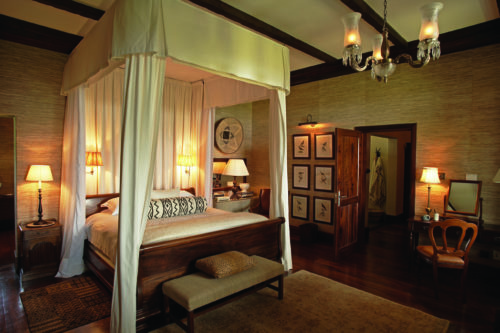 four poster bed and elegant interiors of a luxury suite in the Serengeti